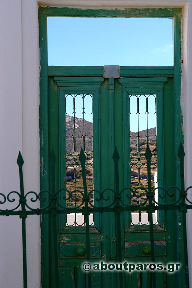A green door in a village of Paros